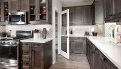 Garage Granite kitchen countertops Kona kitchen cabinets Upgraded flooring Home Smart Package included sq. Kona Kitchen, Granite Kitchen, Kitchen Countertops, Kitchen Dining, Kitchen Cabinets Upgrade, Pardee Homes, Living Room Plan, Home Inventory, New Home Construction