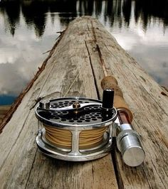 Fly fishing pole on driftwood. - Outdoor Ideas #fishbox #fishing
