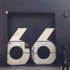 Paint large street number on door.