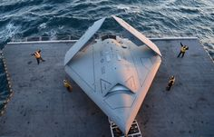 Sailors move an X-47B Unmanned Combat Air System (UCAS) demonstrator onto an aircraft elevator aboard the aircraft carrier USS George H.W. Bush at an unspecified location in the Atlantic Ocean, on May 14.