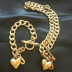 Juicy Couture Necklace and Bracelet Adult time Banner heart necklace and bracelet set. There is somewhere I tried to show it in the second picture. In the second picture it does appear to be worn much more than it is. Juicy Couture Jewelry Necklaces