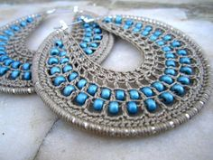 Hand made crocheted hoops. The interior panel is knitted with a very light stone grey thread and teal colour beads within the web.  They are very feminine and unique. If you want to make a strong...