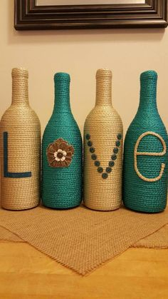Items similar to Decorated Wine Bottles - Set of 4 'LOVE', upcycled wine bottles, home decor, teal and tan wine bottle decor, wedding centerpiece on Etsy Wine Bottle Design, Wine Bottle Art, Diy Bottle, Recycled Glass Bottles, Glass Bottle Crafts, Liquor Bottles, Bottles And Jars, Feng Shui, Diy And Crafts