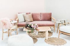 Likes: LOVE the idea of a lounge area w/ couch, chair, & ottoman seating; like the velvet couch   Would want more interesting rugs Read More: https://www.stylemepretty.com/2018/01/30/modern-millennial-pink-inspiration/