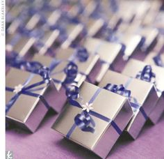 They all just look so pretty! To top off the evenings feast and festivities, guests were treated to edible favors: monogrammed milk chocolate squares, beautifully wrapped in silver boxes with purple ribbon and a small, white cut-out flower. Silver Wedding Favors, Purple And Silver Wedding, Chocolate Wedding Favors, Wedding Favor Boxes, Wedding Favors For Guests, Perfect Wedding, Our Wedding, Wedding Pins, Wedding Doorgift