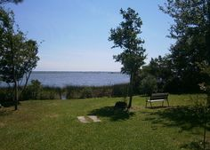 SOLD!!!   390 J Bell Lane, Newport, NC   Anticipation builds as you meander down the private country road-the see the beautiful pristine setting of huge oak trees beckoning you to Bogue sound and all its beauty!  Direct waterfront lot with over 112' on the water!  Large building footprint for your dream home and amenities.  Two existing septic systems and private well.  Existing structure very livable but can be economically removed.   Coastal Federation owns 50' strip to east.
