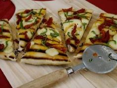 Grilled flatbread pizzas are topped with your choice of seasonings, from cheese, to vegetables like tomatoes, onions, and peppers, to meats, like pepperoni, sausage, Canadian ham or chicken.