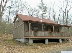 Situated just outside of the Catskill Park in the town of Catskill, this 1000-square foot Cape-style cabin is set back from the road and surrounded by trees on 2 acres of land.