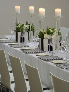 Table linen and centrepieces by Table Art. White Sheer Stripe overlay, Black & White Stripe Napkins, Crystal candlesticks, fabric covered vases with flowers supplied by Flower Jar