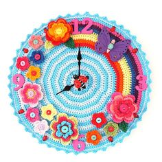 Superb flower-power clock w rainbow, butterflies, and ladybugs :: free #crochet pattern