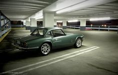 Triumph Spitfire (MkIV?  1500?  I can't tell the difference between later Spits from the outside) with factory hardtop.