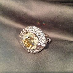 """Beautiful 5k yellow topaz sterling silver ring Sterling silver ring with 5k yellow topaz. Beautiful braided border around stone. NWOT. Bought but never wore.  3/4"""" round. Jewelry Rings"""