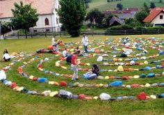 """Marianne Ewaldt labyrinth artist.   """"The children were invited to paint the stones so that they would establish a personal connection with the labyrinth through their 'own stone', thus avoiding vandalism.  In fact children from other schools also often visit the labyrinth outside school hours or in times of stress.  In 2004 a new generation of  schoolchildren enthusiastically repainted all the labyrinth stones. """"  Fantastic idea. 5 tons of stone, 18m diameter."""