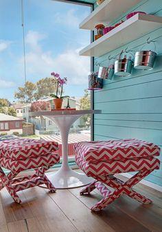 Beach house decor - Love the buckets on hooks for each person.