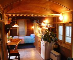 the refurbished interior of the railway carriage makes a restful and inviting space for guests.