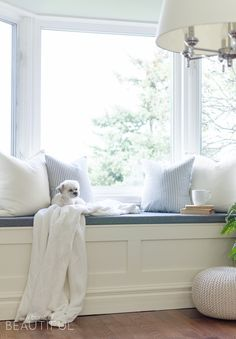 Use matching cabnet doors to make facings upstairs? A DIY window bench with storage adds character and charm to a simple window nook. White Storage Bench, Window Seat Storage, Window Seats, Window Seat Cushions, Window Panels, Bay Window Benches, Living Room Designs, Living Room Decor, Decoration