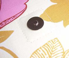 You SEW Girl: How to insert the best magnetic snaps ever.