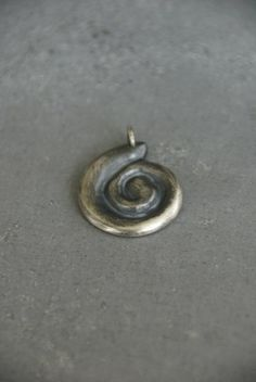 Nautilus Pendant: Wax-carved pendant is cast in sterling silver and has a blackened patina.