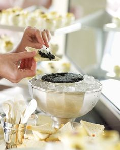Caviar Station - A guest spoons some caviar on a toast point. The silver bowl is from Kevin's collection of antique pieces.