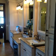Master bath vanity-separate his/her sink with center makeup counter. Also love the center drawers in the makeup counter.