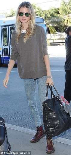 Dressed down: Behati was wearing a soft grey jumper over a white T-shirt, pale skinny jean...