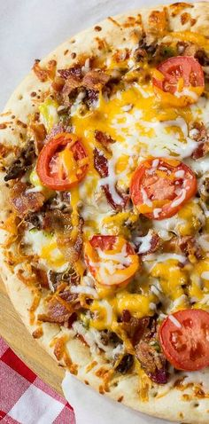 Cheeseburger Pizza ~ with bacon, ground beef, dill pickles, roma tomatoes, and a special sauce made from ketchup and mustard