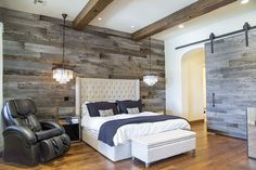 Porter Barn Wood: Here, we installed both the Tobacco Barn Grey Wood Wall Covering + Sliding Barn Door in the Master Bedroom of this home in Scottsdale, AZ. What a great combination of Rustic + Elegance. #barnwood