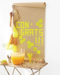 Grad Party Ideas - Hang a Banner Use washi tape to spell out a congratulatory message, and have colorful sticky notes on hand for guests to write their own well-wishes.