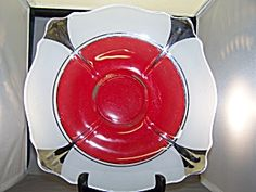 Moderne Classic; Unique vintage art deco shallow bowl with cased red and white glass and silver trim. 11-1/2 inches in diameter with footed base