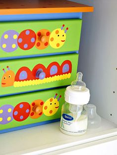Lively Little Drawers - Small, colorful drawers fit nicely on the tall shelves, and contain small tubes of lotion, binkies, and other easily misplaced nursery items.