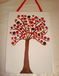 Button canvas. Handpainted tree with buttons glued into place on the branches. Buttons in shades of red, various shapes and sizes. A4 sized. 21cm x