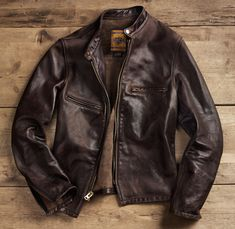 Schott NYC Perfecto Leather Jacket: Amazingly, the Schott Perfecto leather jacket is one product from the golden age of motorcycling that isn't endorsed by Steve McQueen. But this slim-cut leather classic from New York's Schott Leather is a jacket we know he'd love. Zip-front, snap collar closure, distressed top-grain cowhide. Motorcycle optional, aviator shades not included.