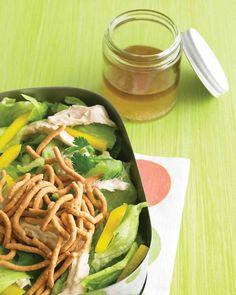 Crunchy Asian Chicken Salad | Martha Stewart Living - Whip up this crowd-pleasing quick Asian chicken salad in just 10 minutes. Toss together shredded chicken breast, iceberg lettuce, yellow bell pepper, and fresh cilantro with a quick sesame-ginger dressing. Top the salad with crunchy chow mein noodles just before serving.