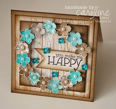 handmade card from C@ro's kaartjes ... woodgrain stamped panel as border and fill in circle window cut out .. browns and tourquoise ... punched flower wreath surrounds the window... great card ... Stampin' Up!