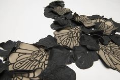 Laser cut leather with intricate patterns inspired by insects; textiles for fashion; fabric manipulation // Daniela Evans