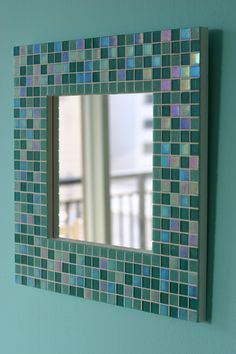 DIY! A Mosaic mirror!! It's really  easy to make this piece of art. Hang it in your bathroom or bedroom. Whalaa! U have not only a beautiful accent you added to your decor, but also you've got a handmade piece of art u put time & dedication into making!