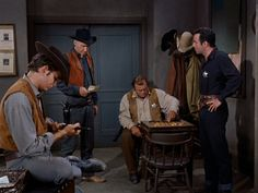 Little Joe, Hoss and Adam wait for Ben's return in the Sherrif's office, until the Sheriff arrives with bad news. - Death at Dawn.