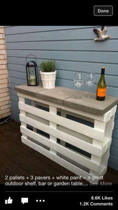 2 pallets+ 3 paver stones + white paint= cute, easy outside table/shelf