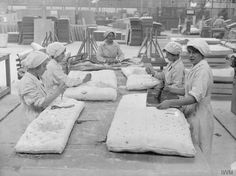 Vintage Photo: Women in a British mattress factory sew and button asbestos-filled mattresses.