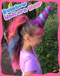 Crazy hair day FAVORITE! Rainbow Unicorn Hair. (We used a Styrofoam cone for horn - spray painted purple before wrapping hair.)