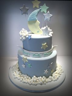 Stars And Moon Baby Shower Cake A stars and moon baby shower cake decorated with mini marshmallows.