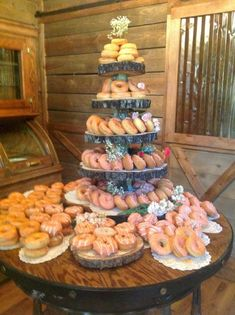 Wedding Donut Bar I have a large 4 tiered nice aluminum tray we could use on a table with a bouquet on the top and 2 smaller rectangular raised trays that would suit this look. Doughnut Wedding Cake, Wedding Donuts, Donut Party, Wedding Desserts, Wedding Cakes, Doughnut Cake, Wedding Snacks, Donut Decorations, Savoury Cake