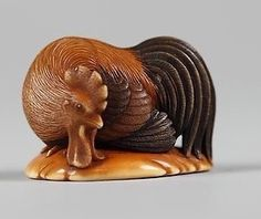 Netsuke of a Chicken. late 19th century. Japan. Ivory. The Met.