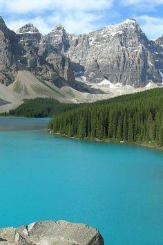 Moraine Lake is a glacially-fed lake in Banff National Park, 14 kilometres (8.7 mi) outside the Village of Lake Louise, Alberta, Canada