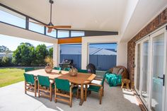 This inviting Queensland outdoor entertaining area has been created as part of the renovation and updating of a brick two storey residential property.  Previously problematic drainage issues were also resolved as part of the creation of this space.