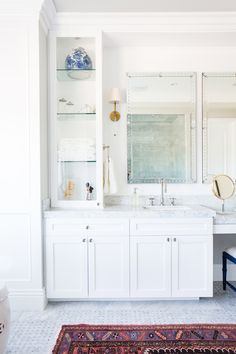 White Bathroom Cabinetry, brass sconces, marble floors || Studio McGee