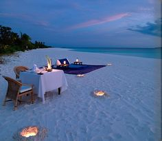 Love the candles in the sand!