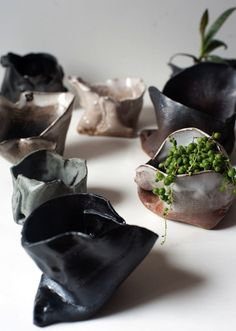 I love the look of these ceramic folded planters.