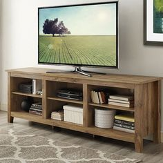 Beachcrest Home Sunbury TV Stand for TVs up to with optional Fireplace Color: Barnwood, Fireplace Included: No Tv Stand With Storage, Diy Tv Stand, 70 Inch Tv Stand, Tv Cabinet Design, Rack Tv, Cool Tv Stands, Tv Furniture, Basement Furniture, Family Room Design