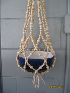Cream Wood Beaded Plant Hanger by syltas on Etsy, $36.00